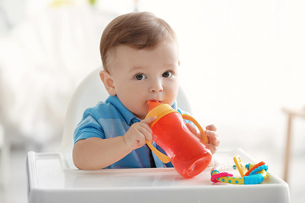 Child drinking from a sippy cup
