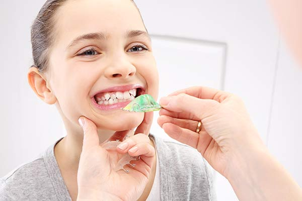 Young girl being fitted for a retainer due to orthodontic issues