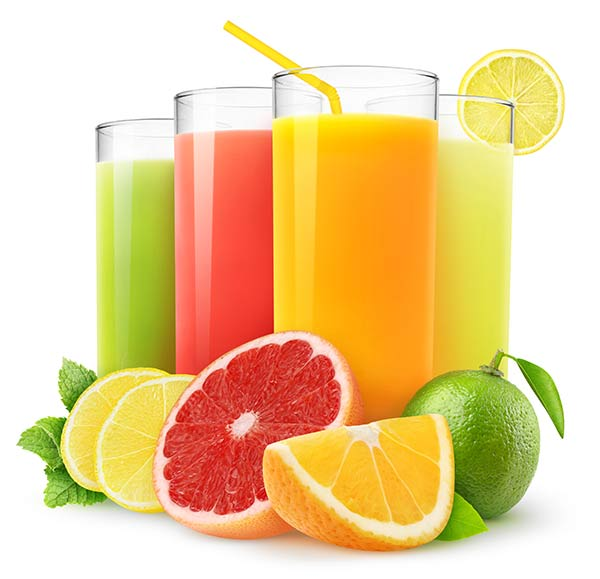 Assortment of citrus drinks in glasses behind sliced citrus fruits