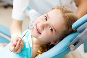 child at dentist to prevent cavities