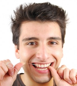 protect your enamel by flossing - 5 ways to damage tooth enamel