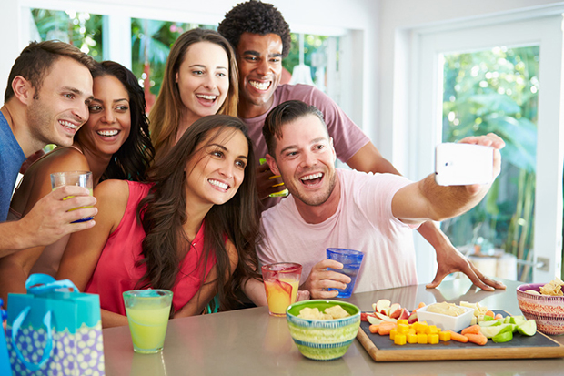 Group Of Friends Smiling and Taking Selfie Whilst Celebrating Birthday - Summer smile makeover