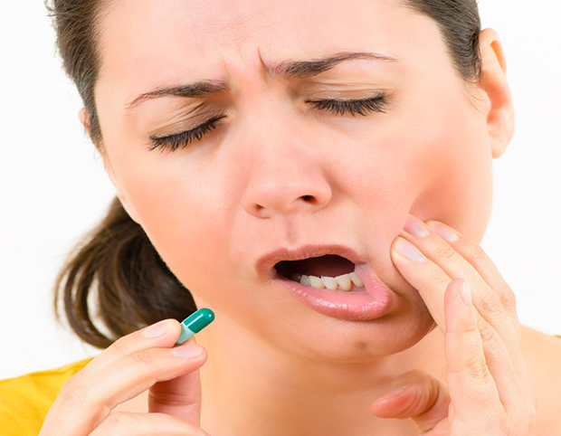 Woman suffering from jaw pain related to TMD - tmd/tmj treatment