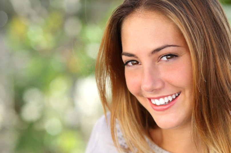 young woman with perfect teeth smiling